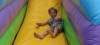 Boy on bouncy slide